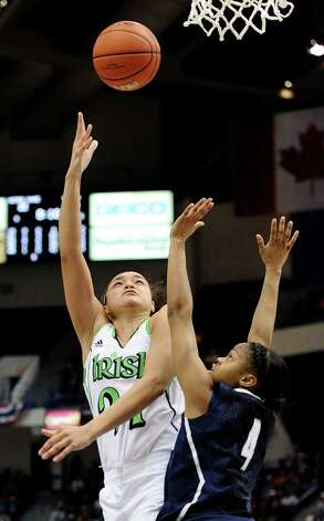 Notre Dame's Kayla McBride goes up for a basket while guarded by Connecticut's Moriah Jefferson in the first half of an NCAA college basketball game in the final of the Big East Conference women's tournament in Hartford, Conn., Tuesday, March 12, 2013. (AP Photo/Jessica Hill) Photo: Jessica Hill, Associated Press / FR125654 AP