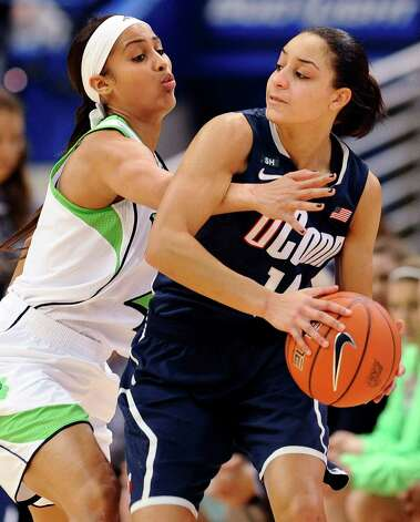 Connecticut's Bria Hartley, right, is guarded by Notre Dame's Skylar Diggins in the first half of an NCAA college basketball game in the final of the Big East Conference women's tournament in Hartford, Conn., Tuesday, March 12, 2013. (AP Photo/Jessica Hill) Photo: Jessica Hill, Associated Press / FR125654 AP