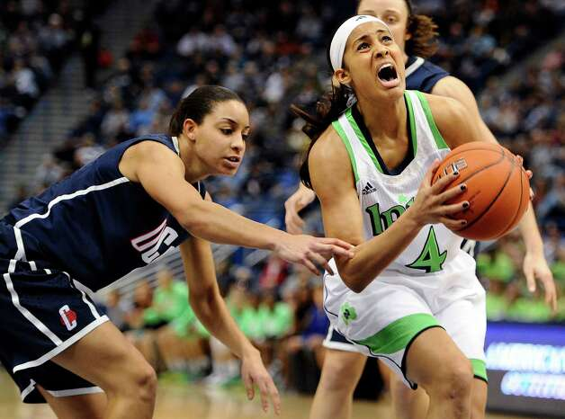 Notre Dame's Skylar Diggins, right, is fouled by Connecticut's Bria Hartley, left, in first half of an NCAA college basketball game in the final of the Big East Conference women's tournament in Hartford, Conn., Tuesday, March 12, 2013. (AP Photo/Jessica Hill) Photo: Jessica Hill, Associated Press / FR125654 AP