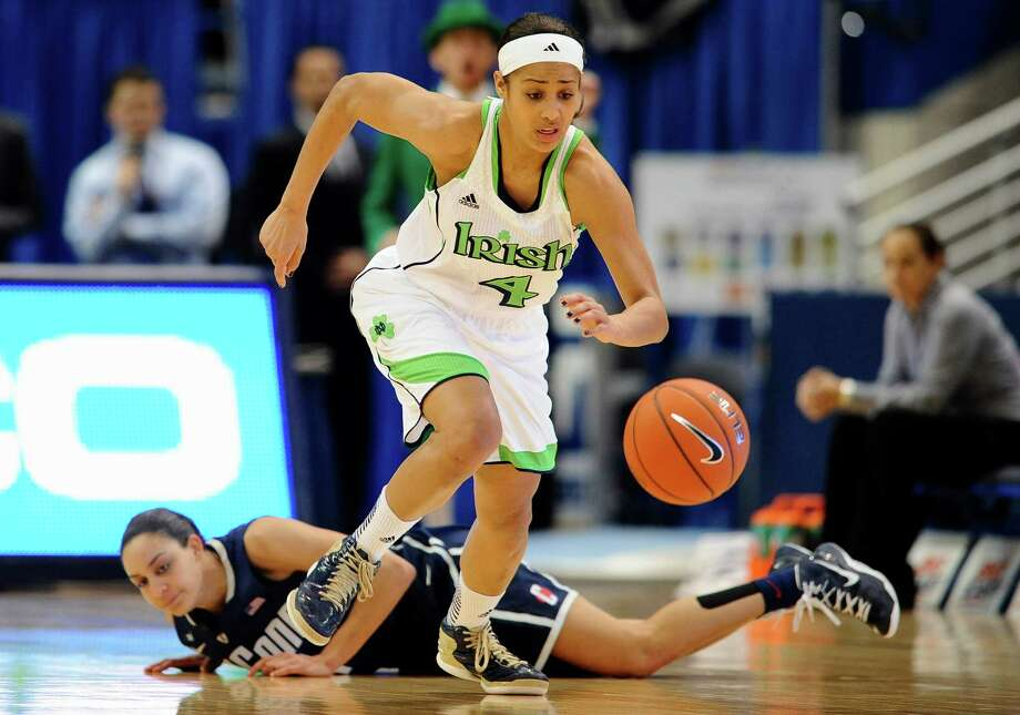 Notre Dame's Skylar Diggins top, steals the ball from Connecticut's Bria Hartley first half of an NCAA college basketball game in the final of the Big East Conference women's tournament in Hartford, Conn in Hartford, Conn., Tuesday, March 12, 2013. (AP Photo/Jessica Hill) Photo: Jessica Hill, Associated Press / FR125654 AP