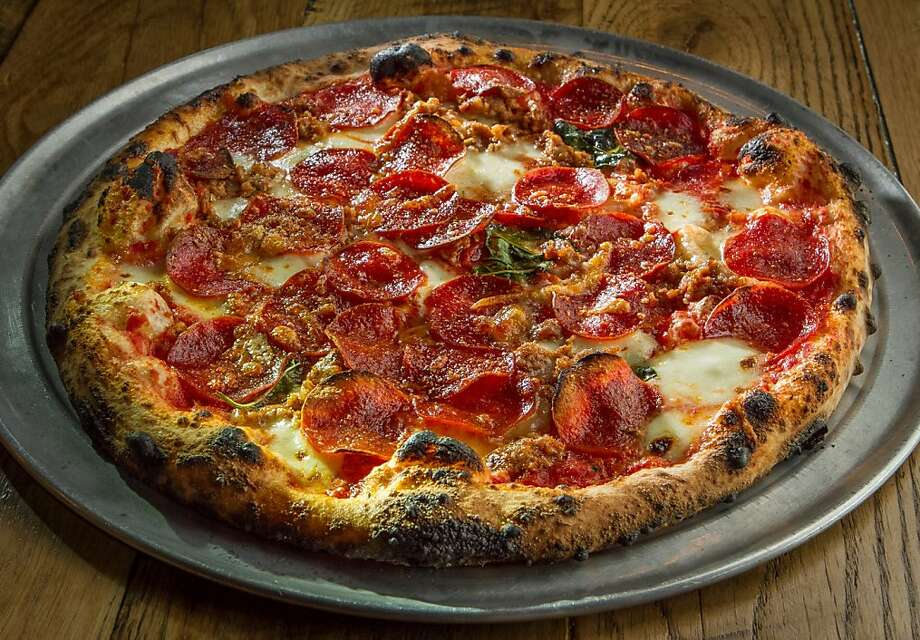 The Escale pizza with mozzarella, basil and Hobb's pepperoni is one of the pies that come out of the wood-fired oven at Pizzalina in San Anselmo. Photo: John Storey, Special To The Chronicle