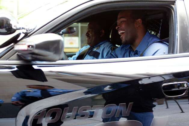Former Houston Texans defensive lineman Mario Williams goes for a drive in one of the five specially equipped 2013 Dodge Chargers he donated to HPD's Traffic Enforcement Division at police headquarters downtown, Tuesday, March 12, 2013, in Houston. In 2011 Williams donated five specially equipped 2011 Chevrolet Camaros to HPD's Traffic Enforcement Division. Willams, said he has been interested in law enforcement  since college, and said he is glad to be able to help keep the streets of Houston safe. Photo: Johnny Hanson, Houston Chronicle / © 2013  Houston Chronicle