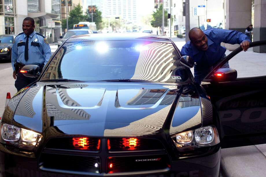 Former Houston Texans defensive lineman Mario Williams gets a closer look at one of the five specially equipped 2013 Dodge Chargers he donated to HPD's Traffic Enforcement Division at police headquarters downtown, Tuesday, March 12, 2013, in Houston. Photo: Johnny Hanson, Houston Chronicle / © 2013  Houston Chronicle