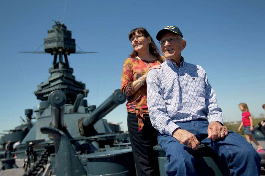 Next to his daughter Shelle Foster McMillan, Cozel Foster, 88, USMC retired, of Eagle Pass, gets a t