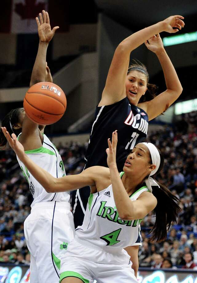 Connecticut's Stefanie Dolson top battle for a rebound with Notre Dame's Skylar Diggins, bottom, and Notre Dame's Markisha Wright, left, in the second half of an NCAA college basketball game in the final of the Big East Conference women's tournament in Hartford, Conn., Tuesday, March 12, 2013. Photo: Jessica Hill