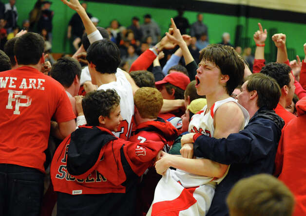 Fairfield Prep's #5 Thomas Nolan celebrates with the rest of his team after they beat East Hartford in Class LL boys basketball semifinal action in Waterbury, Conn. on Tuesday March 12, 2013. Photo: Christian Abraham / Connecticut Post