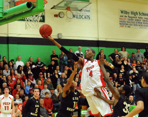 Fairfield Prep's #44 Paschal Chukwu goes up past two East Hartford defenders to lay up to the basket, during Class LL boys basketball semifinal action in Waterbury, Conn. on Tuesday March 12, 2013. Photo: Christian Abraham / Connecticut Post