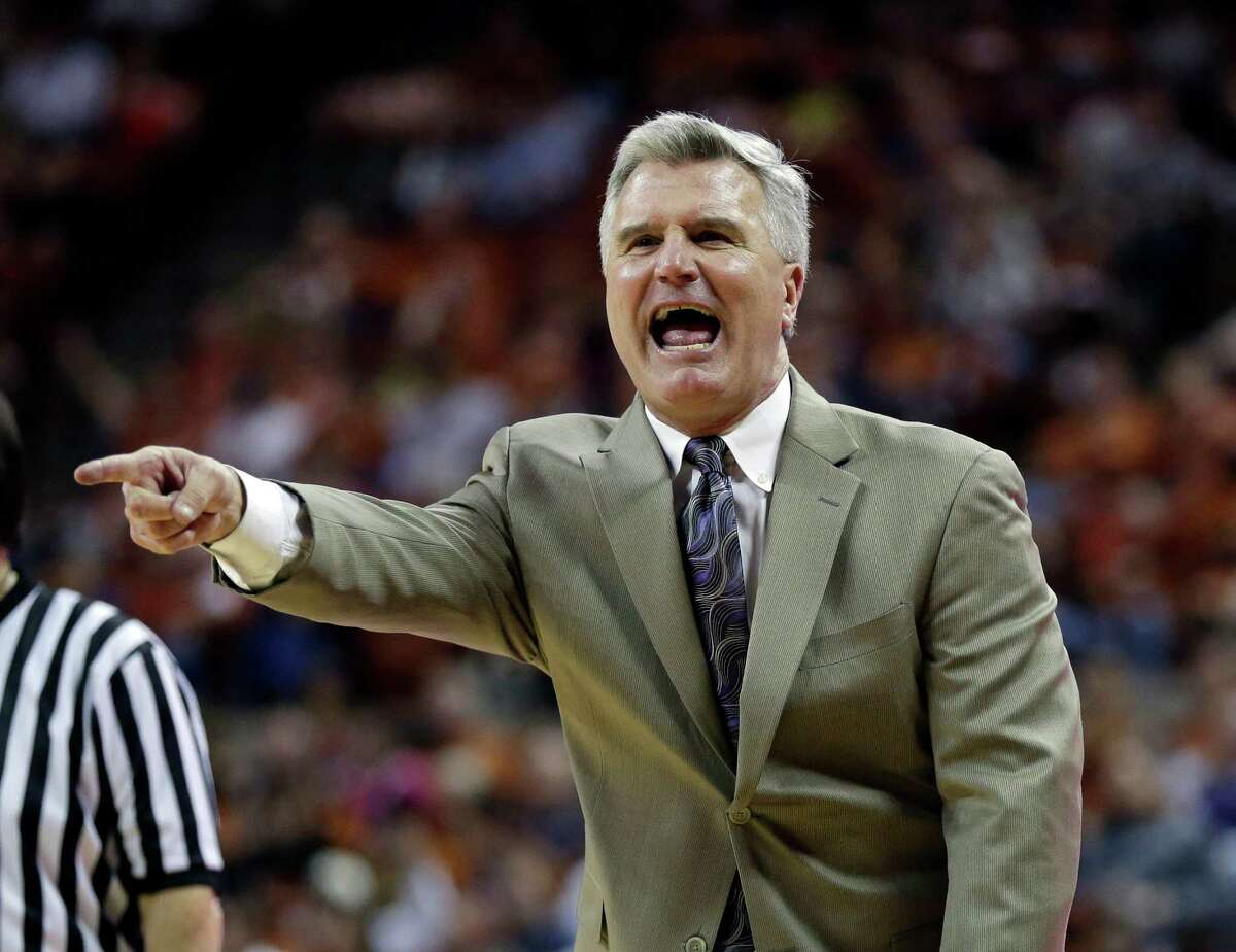 Coach of the Year: Bruce Weber, Kansas State - Only a year after being fired as Illinois' coach, he found new life by taking the Wildcats to a share of their first conference championship since winning the Big Eight in 1977. In the process, the Wildcats won more conference games than any team in school history as Weber became the winningest first-year coach in school history. PHOTO: Weber argues a call during the first half against Texas, Feb. 23, 2013, in Austin.