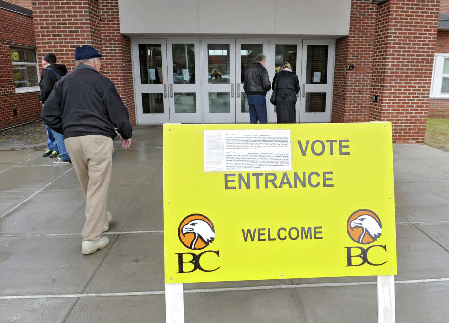 Taxpayers enter Bethlehem High School to vote on nearly $24 million in capital projects under consideration in Bethlehem Central School District on Tuesday March 12, 2013 in Bethlehem, N.Y.  (Lori Van Buren / Times Union) Photo: Lori Van Buren