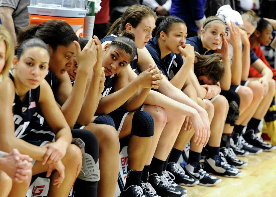 Connecticut reacts after their their loss in the Big East Conference women's tournament championship to Notre Dame in an NCAA college basketball game in Hartford, Conn., Tuesday, March 12, 2013. (AP Photo/Jessica Hill) Photo: Jessica Hill, Associated Press / FR125654 AP