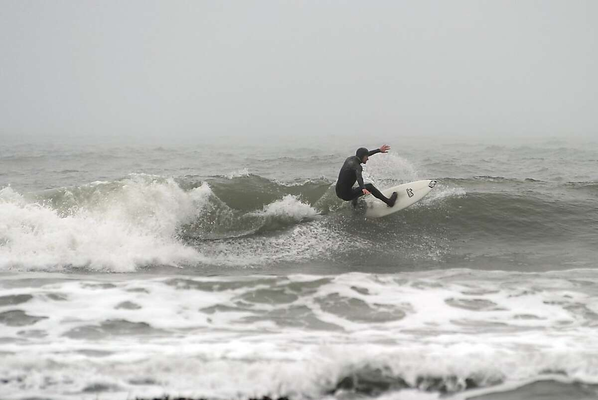 Surfer Dylan Christensen of Oakland enjoying the waves at Martin's Beach in Half Moon Bay Tuesday March 12th, 2013.