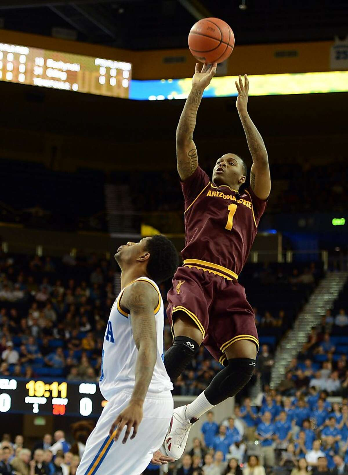 LOS ANGELES, CA - FEBRUARY 27: Jahii Carson #1 of the Arizona State Sun Devils shoots a jumper over Larry Drew II #10 of the UCLA Bruins at Pauley Pavilion on February 27, 2013 in Los Angeles, California. (Photo by Harry How/Getty Images)