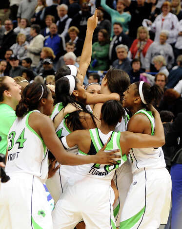Notre Dame celebrates their Big East Conference women's tournament championship win over Connecticut in an NCAA college basketball game in Hartford, Conn., Tuesday, March 12, 2013. (AP Photo/Jessica Hill) Photo: Jessica Hill, Associated Press / FR125654 AP