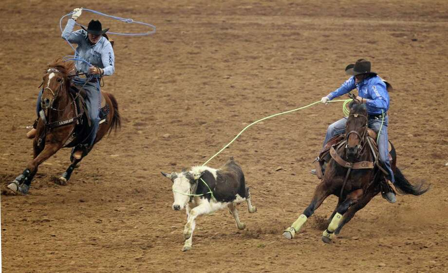Brandon Beers and Jade Corkill competes in Team Roping during the BP Super Series V Championship at Reliant Stadium on Tuesday, March 12, 2013, in Houston. Photo: Mayra Beltran, Houston Chronicle / © 2013 Houston Chronicle