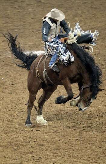 Wade Sundell competes in the Saddle Bronc during the BP Super Series V Championship at Reliant Stadi