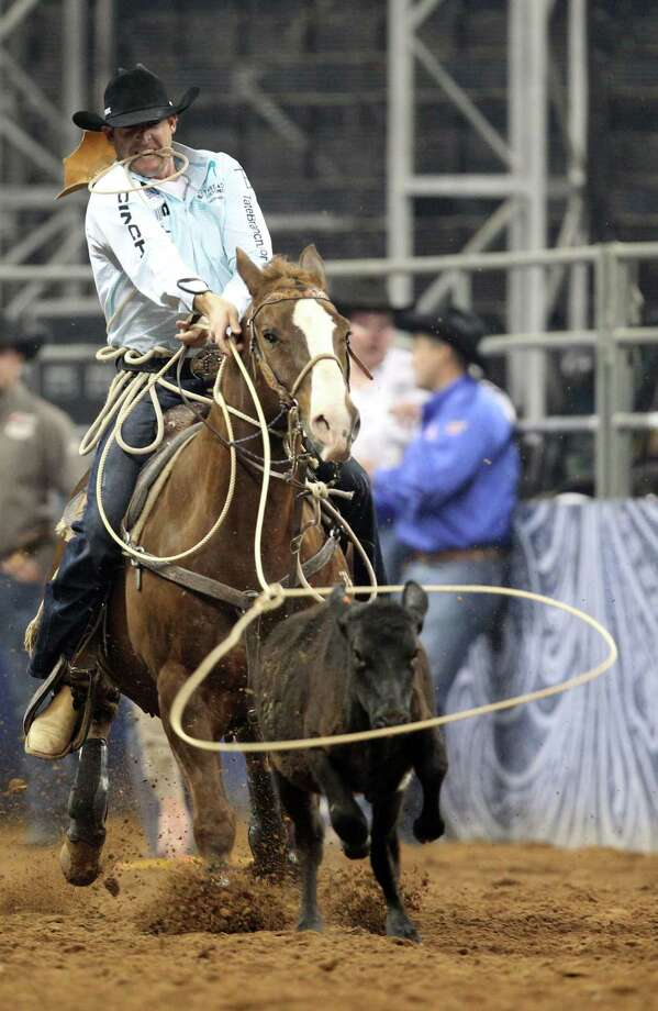 Clint Cooper competes in Tie-Down Roping during the BP Super Series V Championship at Reliant Stadium on Tuesday, March 12, 2013, in Houston. Photo: Mayra Beltran, Houston Chronicle / © 2013 Houston Chronicle