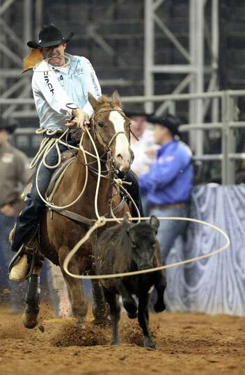 Clint Cooper competes in Tie-Down Roping during the BP Super Series V Championship at Reliant Stadiu