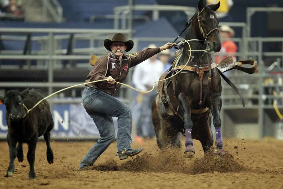 Tuf Cooper competes in Tie-Down Roping during the BP Super Series V Championship at Reliant Stadium on Tuesday, March 12, 2013, in Houston. Photo: Mayra Beltran, Houston Chronicle / © 2013 Houston Chronicle