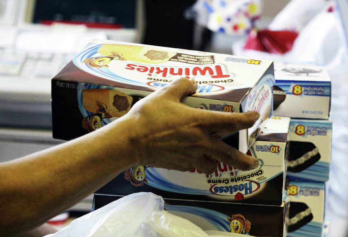 In a blast from the past, a cashier in Denver rings up boxes of Hostess Twinkies in November. Hostess said Tuesday that it had picked a partnership of two investment firms, Apollo Global Management and Metropoulos & Co., as the new owner of its snack cake business.