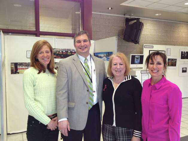 Planning for the League of Women Voters forum on mobile technology in the schools, on Tuesday, March 26, from 6:30 - 9 p.m. at the high school are, from left, Kate Hurlock, league presiden, Bryan Luizzi, NCHS principal and forum moderator,and Anita Peters and Lisa Vasquez, league program chairmen. Photo: Contributed Photo