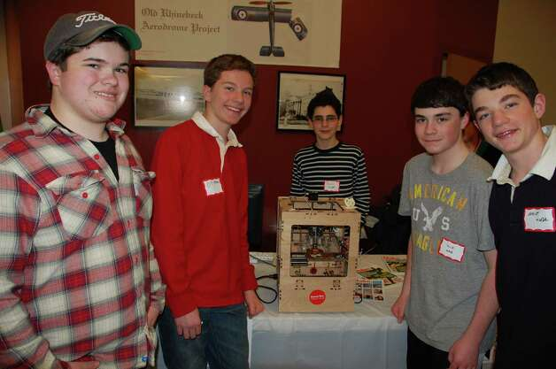 Proudly standing around their homemade 3-D printer are, from left, Chip Mahoney, 15, high school liaison to the Saxe Middle School Tech Team, D.J. Morse, 13, Jason Campe, 13, Jack Reed, 14, and Grant Morse, 12. Team members displayed their printer at the annual Tech Night Feb. 26. Photo by Jarret Liotta Photo: Contributed Photo