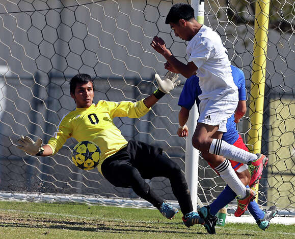 Mustang goalkeeper Jose Perez drops to defend against a shot by Edison's Jose Castillo as Jefferson beats Edison 1-0 in soccer at the SAISD Spring Sports Complex on March 12, 2013. Photo: Tom Reel, San Antonio Express-News