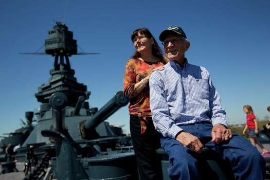 Cozel Foster, 88, finds a place to take a break Tuesday after a tour of the Battleship Texas with his daughter, Shelle Foster McMillan. The Eagle Pass retiree hadn't seen the historic ship since the end of World War II. Photo: Johnny Hanson, Staff / © 2013  Houston Chronicle
