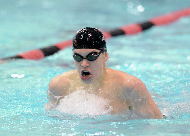 Oscar Ike of Westhill/Stamford Combined competes in the 200 IM during the Class LL boys swimming championship at Wesleyan University, Middletown, Conn., Tuesday, March 12, 2013. Photo: Bob Luckey / Greenwich Time