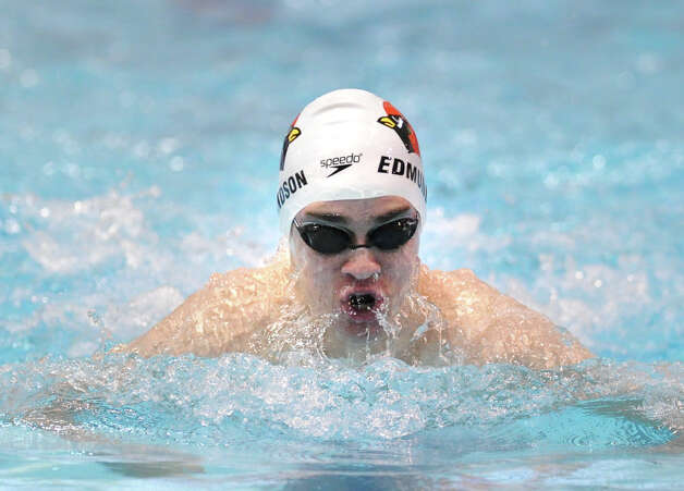 Iain Edmundson of Greenwich swims in the 200 IM event during the Class LL boys swimming championship at Wesleyan University, Middletown, Conn., Tuesday, March 12, 2013. Photo: Bob Luckey / Greenwich Time
