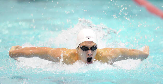 Alex Lewis of Greenwich competes in the 100 butterfly event that he won during the Class LL boys swimming championship at Wesleyan University, Middletown, Conn., Tuesday, March 12, 2013. Photo: Bob Luckey / Greenwich Time