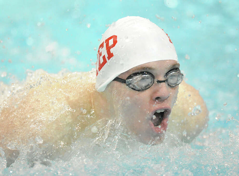 Byrce Keblish of Fairfield Prep competes in the 100 butterfly event during the Class LL boys swimming championship at Wesleyan University, Middletown, Conn., Tuesday, March 12, 2013. Photo: Bob Luckey / Greenwich Time