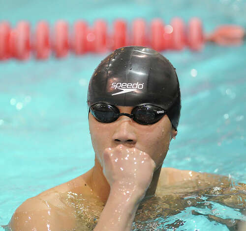 Sherman Lau of Norwalk after competing in the 100 yard freestyle event during the Class LL boys swimming championship at Wesleyan University, Middletown, Conn., Tuesday, March 12, 2013. Photo: Bob Luckey / Greenwich Time