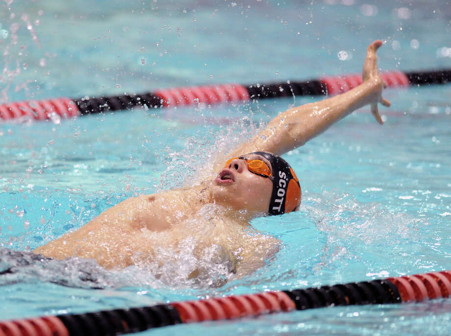 Noah Scott of Ridgefield High School competes in the 100 backstroke event during the Class LL boys swimming championship at Wesleyan University, Middletown, Conn., Tuesday, March 12, 2013. Photo: Bob Luckey / Greenwich Time