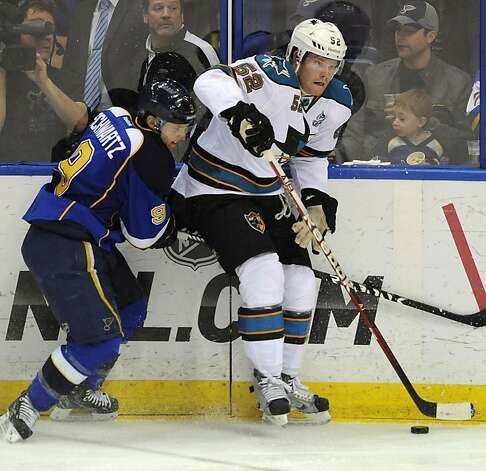 St. Louis Blues' Jaden Schwartz (9) and San Jose Sharks' Matt Irwin (52) battle for a loose puck in the second period of an NHL hockey game Tuesday, March 12, 2013, in St. Louis. (AP Photo/Bill Boyce) Photo: Bill Boyce, Associated Press