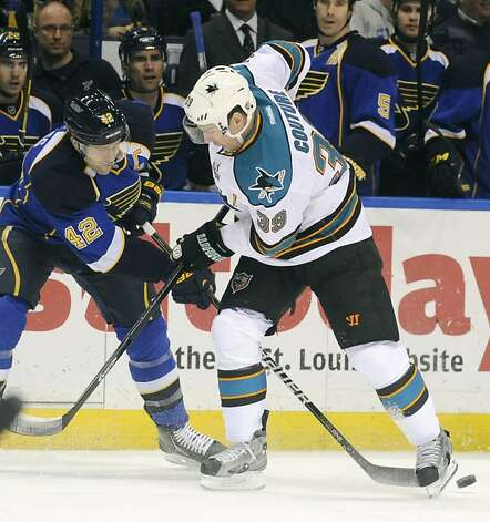 St. Louis Blues' David Backes (42) battles with San Jose Sharks' Logan Couture (39) in the first period of an NHL hockey game Tuesday, March 12, 2013, in St. Louis. (AP Photo/Bill Boyce) Photo: Bill Boyce, Associated Press