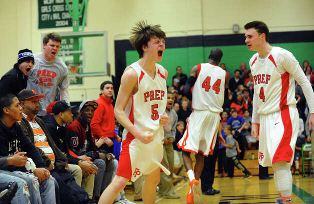 Fairfield Prep's #5 Thomas Nolan celebrates a basket, during Class LL boys basketball semifinal action against East Hartford in Waterbury, Conn. on Tuesday March 12, 2013. Photo: Christian Abraham / Connecticut Post
