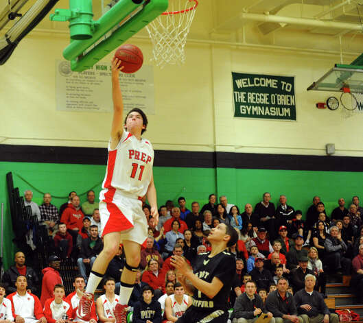 Fairfield Prep's #11 David Zielinski lays up to the basket, during Class LL boys basketball semifinal action against East Hartford in Waterbury, Conn. on Tuesday March 12, 2013. Photo: Christian Abraham / Connecticut Post