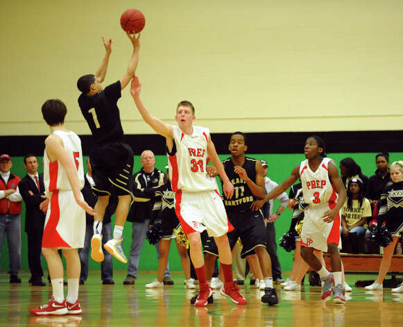 Fairfield Prep's #33 Tim Butala defends as an East Hartford player attempts a shot, during Class LL boys basketball semifinal action in Waterbury, Conn. on Tuesday March 12, 2013. Photo: Christian Abraham / Connecticut Post