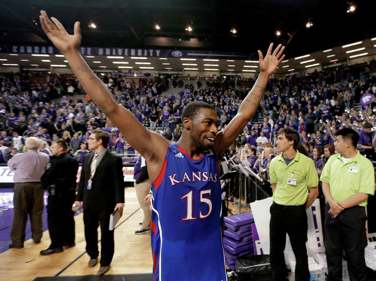 Kansas (26-5, 14-4) Best Big 12 finish: Won in 2011, 2010, 2008, 2007, 2006, 1999, 1998, 1997 Best wins: Colorado (90-54), at Ohio State (74-66), Kansas State (83-62) Worst loss: at Baylor (81-58) Player to watch: PG Elijah Johnson - For all of the talk about All-Big 12 players Jeff Withey and Ben McLemore, the Jayhawks are at their best when receiving strong point-guard play. Big production from Johnson will be vital in Kansas City and beyond. Chance of moving on: The Jayhawks showed some cracks late in the season with an un-Kansas-like three-game losing streak and failing to win a road game in regulation since Jan. 28. But it's wise to never pick against Bill Self in a tournament setting, particularly when it's played in Kansas City. PHOTO: Kansas guard Elijah Johnson celebrates after defeating Kansas State 59-55, Jan. 22, 2013, in Manhattan, Kan.