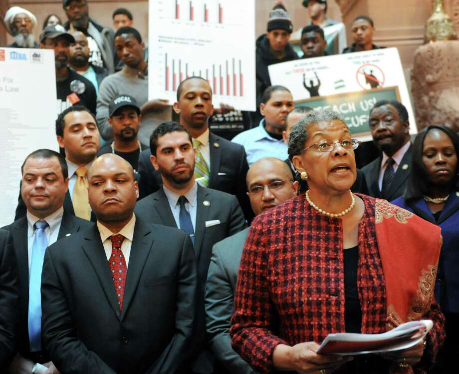 Senator Ruth Hassell-Thompson, lower right, speaks during a news conference on Tuesday, March 12, 2013, at the Capitol in Albany, N.Y. State lawmakers who are members of The New York State Black, Puerto Rican, Hispanic and Asian Legislative Caucus, and community members gathered to promote ending arrests for low-level possession of marijuana. (Cindy Schultz / Times Union) Photo: Cindy Schultz / 10021523A