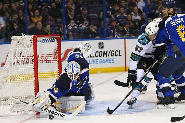 Blues goalie Jake Allen brushed aside most of what Tommy Wingels (57) and the Sharks threw at him Tuesday night. Photo: Dilip Vishwanat, Getty Images