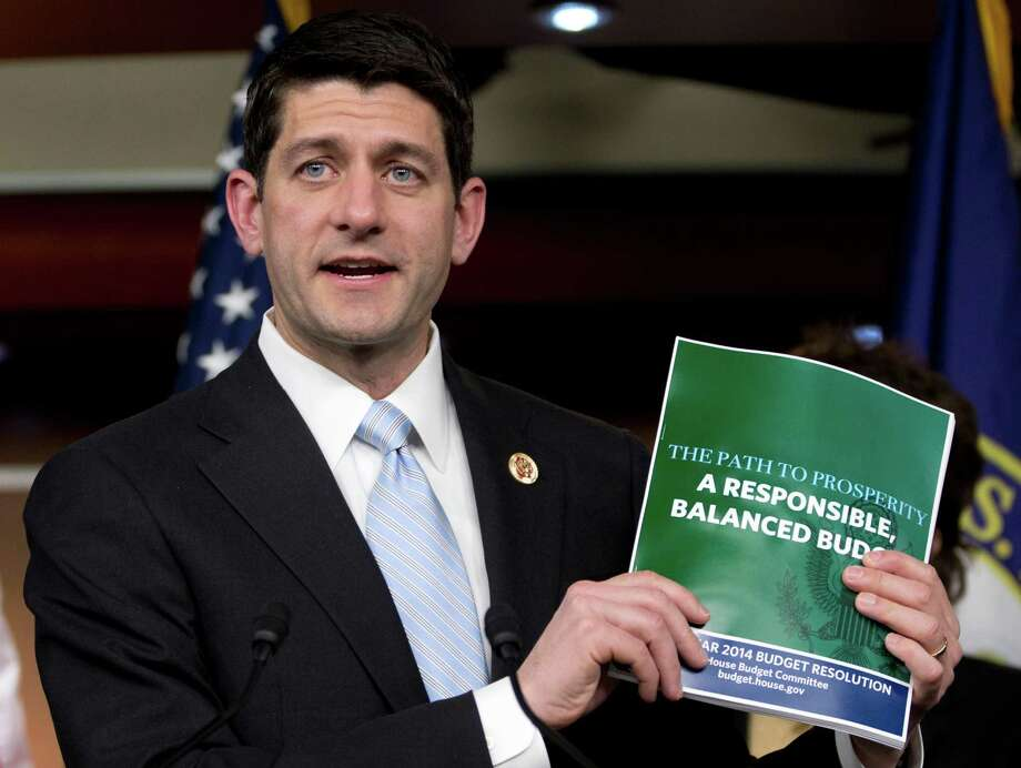 House Budget Committee Chairman Rep. Paul Ryan, R-Wis., holds up a copy of the House Budget Committee 2014 Budget Resolution as he speaks during a news conference on Capitol Hill in Washington, Tuesday, March 12, 2013. (AP Photo/Carolyn Kaster) Photo: Carolyn Kaster