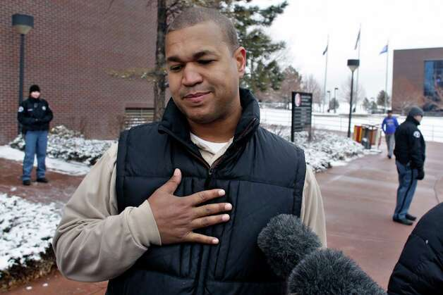 Aurora theater shooting victim Marcus Weaver speaks with members of the media following the arraignment of Aurora shooting suspect James Holmes, at district court in Centennial, Colo., on Tuesday, March 12, 2013. Judge William Blair Sylvester entered a not guilty plea on behalf of Holmes on Tuesday after the former graduate student's defense team said he was not ready to enter one. Holmes is charged with killing 12 people and wounding more than 50 in a crowded Colorado movie theater last year. (AP Photo/Brennan Linsley) Photo: Brennan Linsley