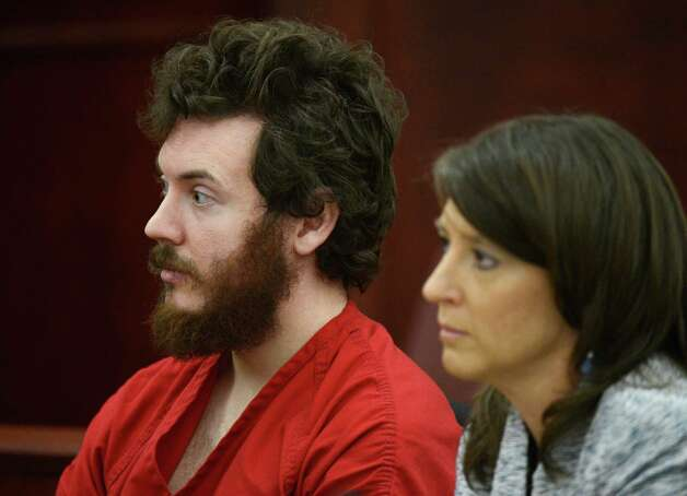 James Holmes sits with defense attorney Tamara Brady during his arraignment in district court in Centennial, Colo., on Tuesday, March 12, 2013. Judge William Blair Sylvester entered a not guilty plea on behalf of James Holmes on Tuesday after the former graduate student's defense team said he was not ready to enter one. (AP Photo/Denver Post, RJ Sangosti, Pool) Photo: RJ Sangosti