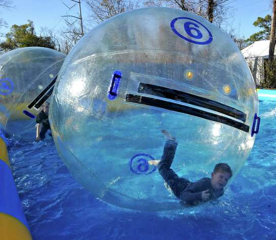Rolling around in a giant bubble in a big tank of water is Cameron Lovelace.  The annual Nederland Heritage Festival kicked off Tuesday afternoon in downtown Nederland.  It will run through the rest of the week. Dave Ryan/The Enterprise Photo: Dave Ryan