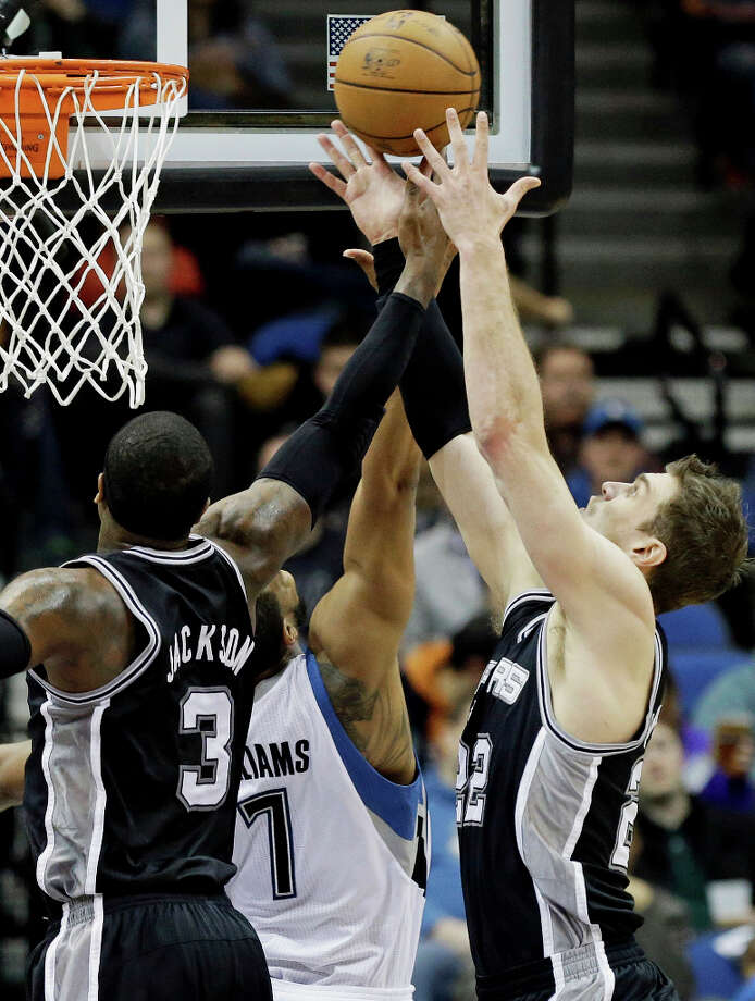 San Antonio Spurs' Stephen Jackson, left, and Tiago Splitter of Brazil, right, battle Minnesota Timberwolves' Derrick Williams for the rebound  in the first half of an NBA basketball game Tuesday, March 12, 2013, in Minneapolis. Photo: Jim Mone, Associated Press / AP