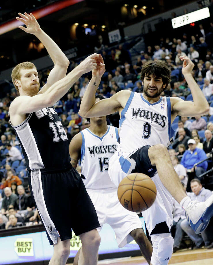 Minnesota Timberwolves' Ricky Rubio of Spain, right, causes San Antonio Spurs' Matt Bonner to lose the ball in the first half of an NBA basketball game Tuesday, March 12, 2013, in Minneapolis. Photo: Jim Mone, Associated Press / AP