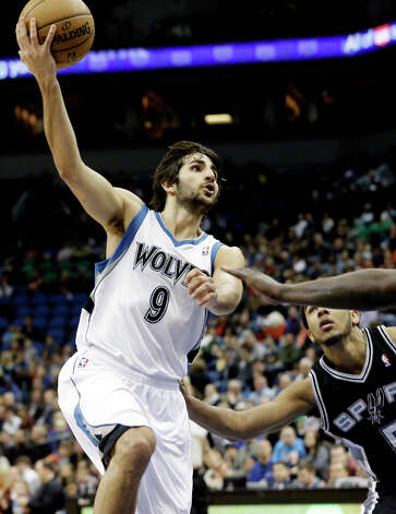Minnesota Timberwolves' Ricky Rubio of Spain shoots as San Antonio Spurs' Cory Joseph, right, watches in the second half of an NBA basketball game Tuesday, March 12, 2013, in Minneapolis. Rubio had a triple double with 21 points, 12 assists and 13 rebounds in the Timberwolves' 107-83 win. Joseph led the Spurs with 15 points. Photo: Jim Mone, Associated Press / AP