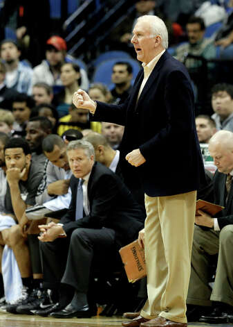 San Antonio Spurs head coach Gregg Popovich calls out instructions in the second half of an NBA basketball game against the Minnesota Timberwolves Tuesday, March 12, 2013, in Minneapolis. The Timberwolves won 107-83. Photo: Jim Mone, Associated Press / AP