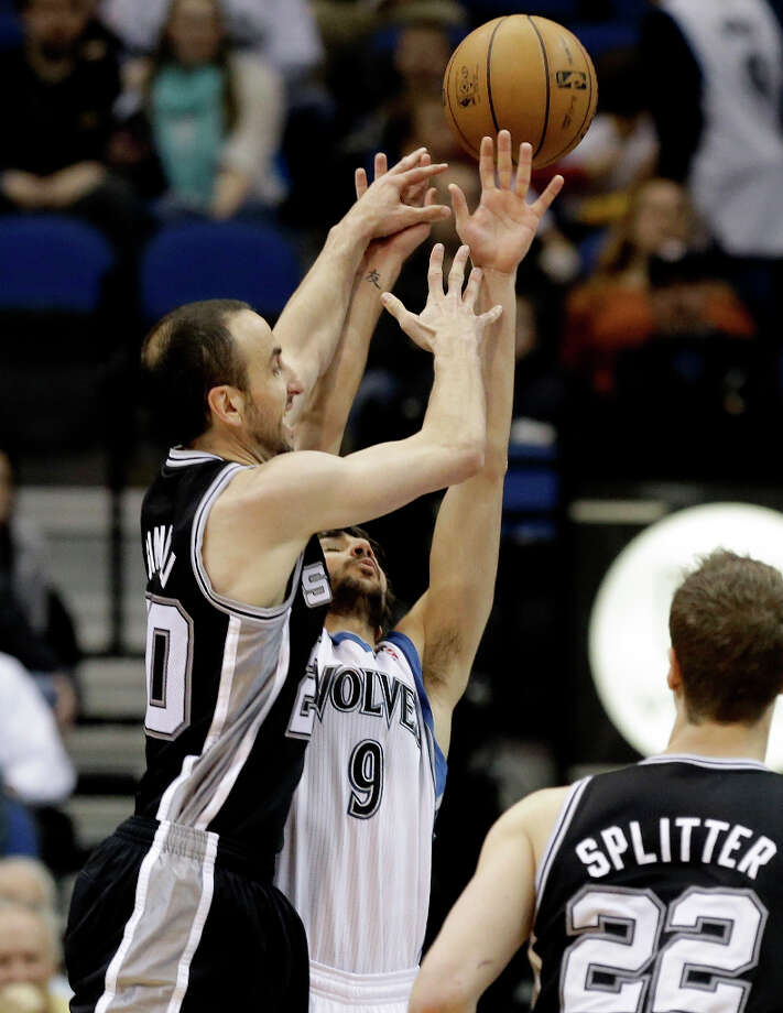 San Antonio Spurs' Manu Ginobili of Argentina, left, releases a shot over the defensive efforts of Minnesota Timberwolves' Ricky Rubio of Spain in the second half of an NBA basketball game Tuesday, March 12, 2013, in Minneapolis. The Timberwolves won 107-83. Photo: Jim Mone, Associated Press / AP